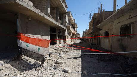 Bandera siria en una calle de Palmira, Siria, el 20 de abril de 2016.