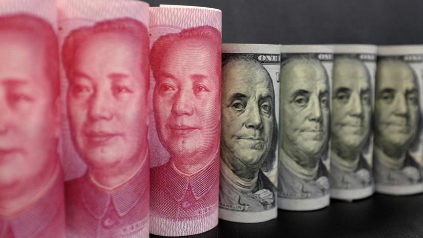 Bancos de China compran y venden dólares para respaldar al yuan