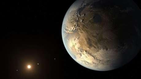 Representación artística de Kepler-186f, el primer exoplaneta de un tamaño equiparable con la Tierra confirmado en orbitar su astro a una distancia que le permite mantener el agua líquida
