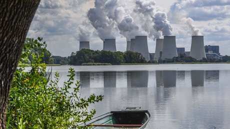 Smoke rises above cooling towers at the Jängschwalde power station in Germany
