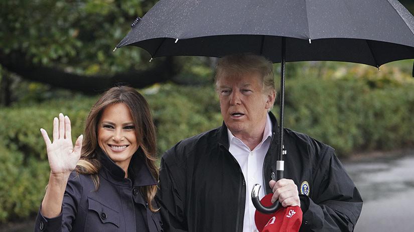 Donald Trump, criticado por no compartir el paraguas con su mujer