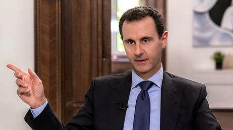 El presidente sirio, Bashar al Assad, durante una entrevista con la cadena de televisión rusa NTV, Damasco, Siria, 24 de junio de 2018.