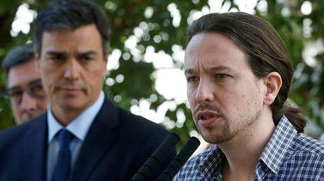 El líder de Podemos, Pablo Iglesias, junto al presidente español Pedro Sánchez. Madrid, 15 de julio de 2016.