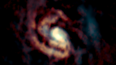 Gas around the black hole in the center of the compass galaxy.