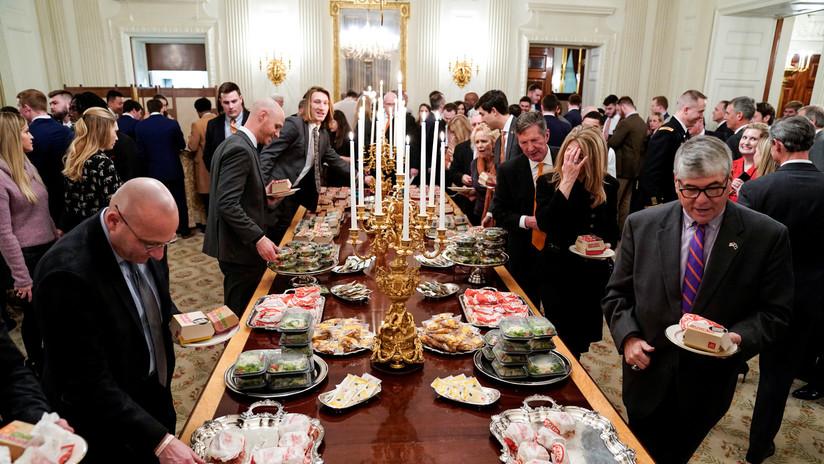 """Invitan a una """"auténticacena de celebración"""" a los deportistas recibidos por Trump con hamburguesas"""