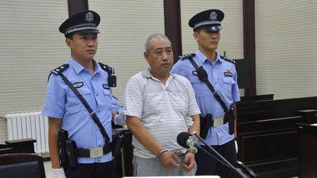 Gao Chengyong, apodado 'Jack el destripador' chino, durante un juicio en la ciudad de Baiyin (China), el 18 de julio de 2017.