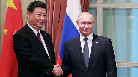 El presidente chino, Xi Jinping, y su homólogo ruso, Vladímir Putin, durante una reunión en Buenos Aires, Argentina, el 30 de noviembre de 2018.
