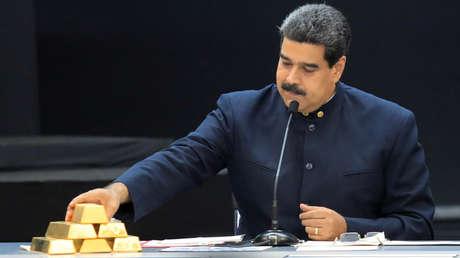 El presidente de Venezuela, Nicolás Maduro, en una reunión con los ministros del sector económico en el Palacio de Miraflores de Caracas, el 22 de marzo de 2018