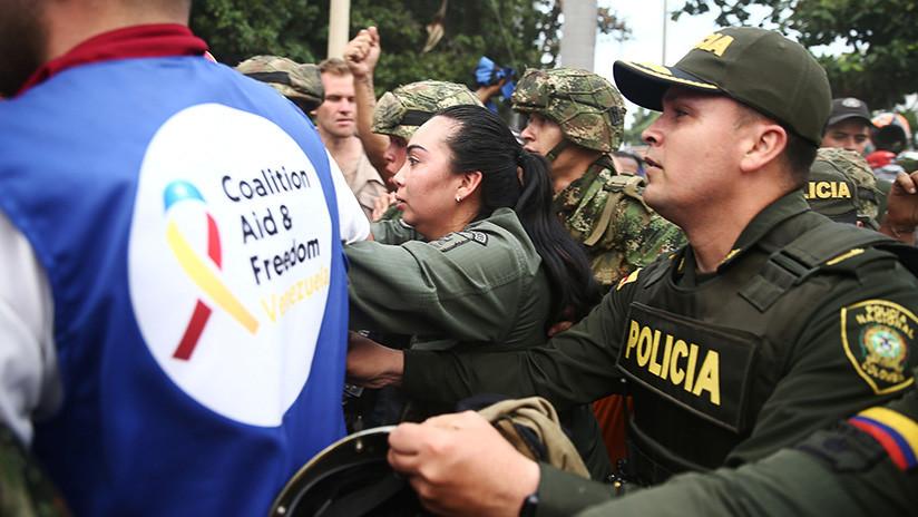 La Policía de Venezuela usa gases lacrimógenos contra manifestantes que intentan entrar por la fuerza desde Colombia