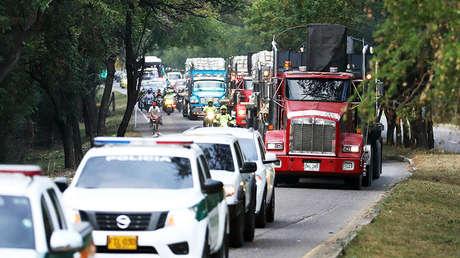 Camiones con ayuda humanitaria de la USAID para Venezuela llegan al puente Tienditas en Cúcuta (Colombia) escoltados por la Policía, el 16 de febrero de 2019.