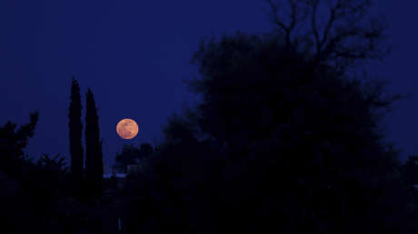Pink full moon seen from the suburb of Lakatamia, located in the Cypriot capital Nicosia, on April 19, 2019.