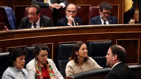 Oriol Junqueras (abajo), Jordi Sánchez (d), Josep Rull (i) y Jordi Turull (c) en el Parlamento. Madrid, 21 mayo 2019.
