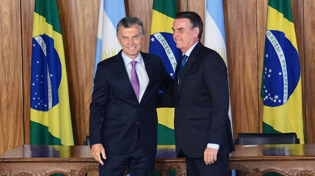 Mauricio Macri y Jair Bolsonaro son fotografiados después de firmar un acuerdo en el Palacio Planalto en Brasilia. 16 de enero del 2019.