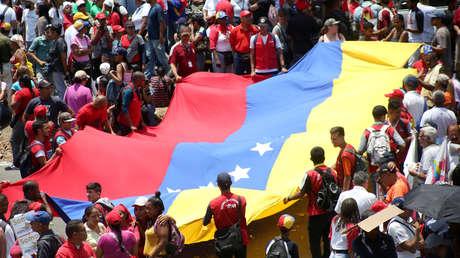 Partidarios del Nicolás Maduro asisten a un mitin en apoyo de su Gobierno, el 1 de mayo de 2019.