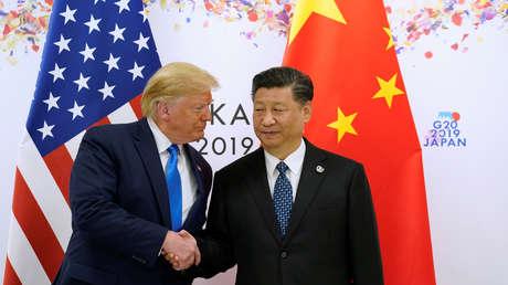 Donald Trup y Xi Jinping se dan la mano en la cumbre del G20 de Osaka (Japón), el 29 de junio de 2019.