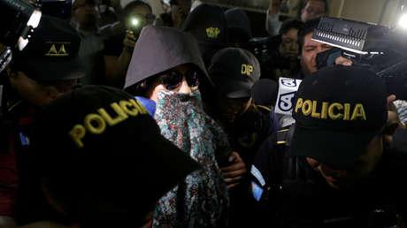 La Policía escolta a la excandidata presidencial Sandra Torres al tribunal tras su detención, Ciudad de Guatemala, 2 de septiembre de 2019.