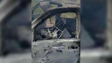 Los restos quemados del vehículo que transportaba a la familia mormona LeBarón, Bavispe (México), 4 de noviembre de 2019.