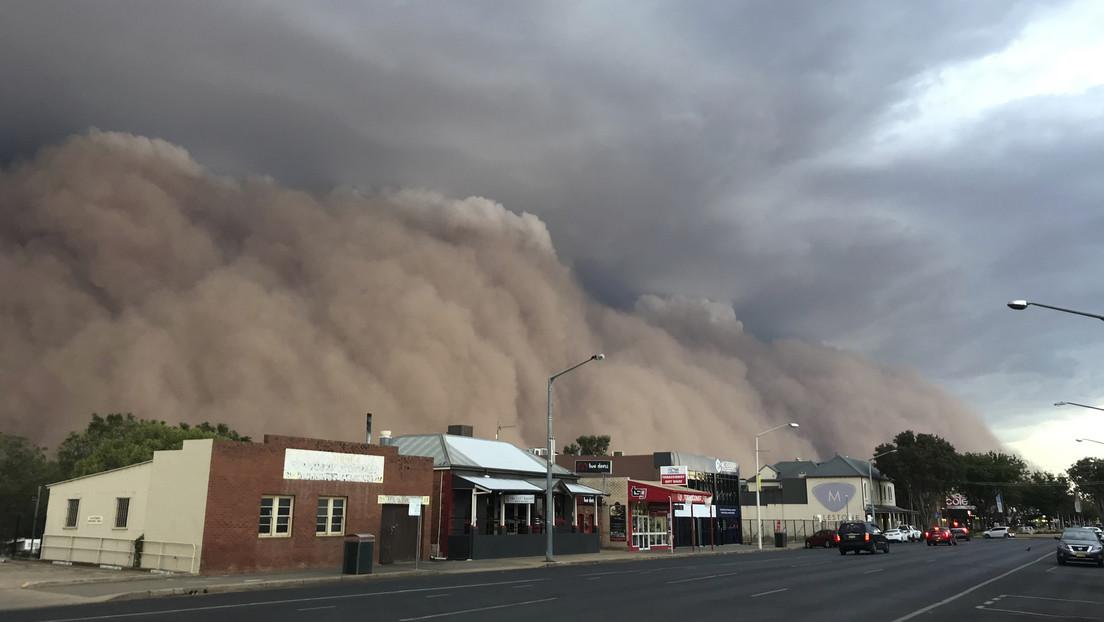 FOTOS: Enormes tormentas de polvo sumergen en la oscuridad partes de Australia mientras la capital del país se cubre de granizo