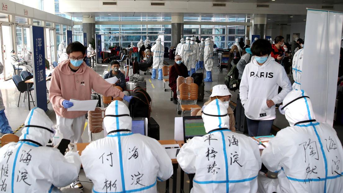 China prohíbe temporalmente la entrada a la mayoría de extranjeros para frenar los casos importados de coronavirus