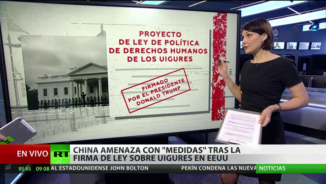 """Pekín amenaza con """"medidas"""" tras la firma de una ley en EE.UU. sobre uigures"""