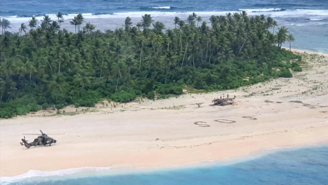 Una señal de SOS gigante escrita en la arena salva a tres hombres varados en una isla deshabitada