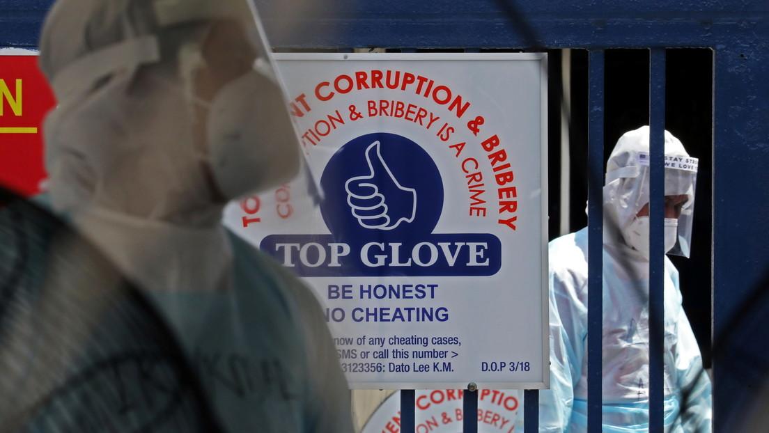 El mayor fabricante de guantes de goma del mundo cierra parcialmente luego de que miles de sus empleados dieran positivo para covid-19