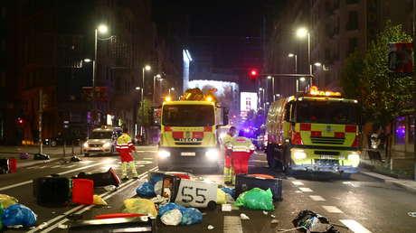 VIDEOS: Barricadas y contenedores en llamas durante una protesta en Madrid contra las restricciones por el covid-19