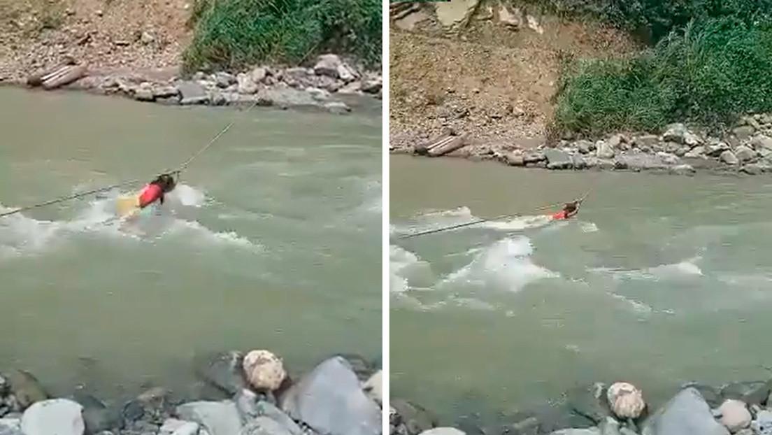 Lo que hay detrás de las imágenes de una niña indígena que cruza a contracorriente un río torrentoso en Colombia (VIDEO)