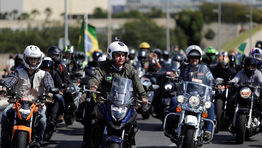 Multan a Bolsonaro por no usar una mascarilla durante un recorrido con sus partidarios en motocicletas