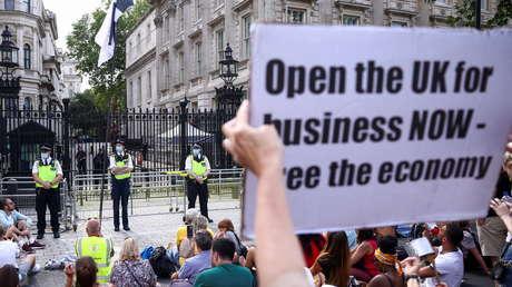 Miles de personas protestan en la capital del Reino Unido contra las restricciones de la pandemia (FOTOS, VIDEOS)