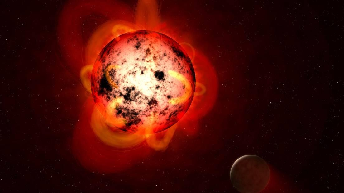 Ilustración artística muestra una estrella enana roja orbitada por un exoplaneta hipotético.