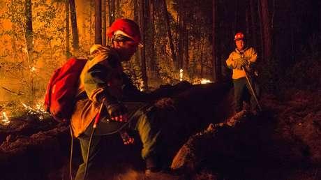 VIDEOS, FOTOS: 'Desaparece' el sol en algunas zonas de Siberia en medio de fuertes incendios forestales