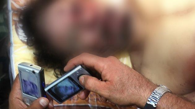 VIDEO: nuevas imágenes de los rebeldes libios abusando del cadáver de Gaddafi