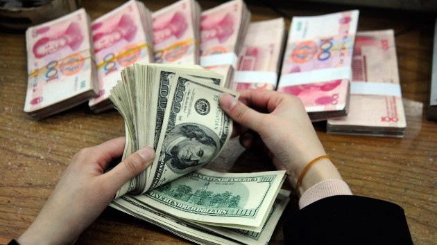 Moda de los ricos chinos: publicar fotos de dinero en la Red