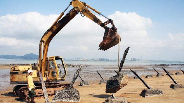 ¿Será construcción de gran isla artificial en el mar de China meridional la jugada maestra de China?