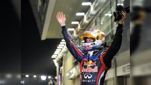 Vettel, ganador del GP de Singapur, a un paso del título