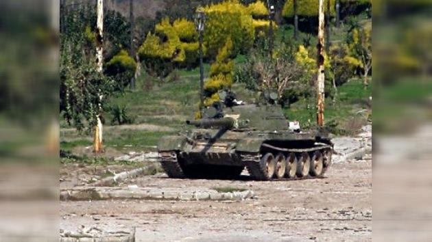 Damasco dice que el Ejército sirio tomó el control del Homs rebelde