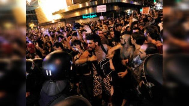Los indignados buscan 'reconquistar' el centro de Madrid, acordonado para recibir al Papa