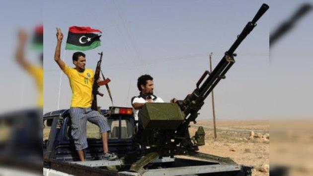 Los rebeldes libios buscan a Gaddafi en su último bastión