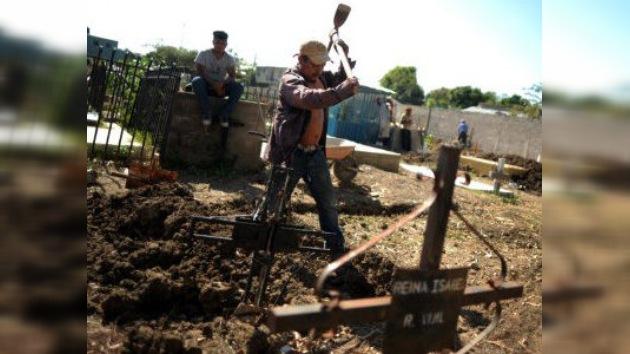 Honduras empieza a dar el último adiós a los reos muertos en el incendio