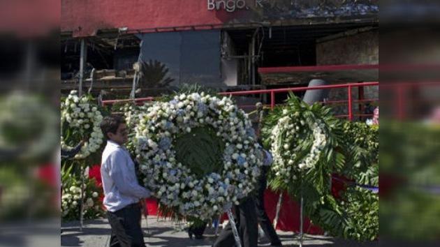 Misa multitudinaria por las víctimas del Casino Royale en Monterrey