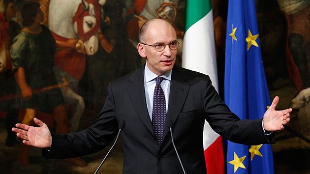 El primer ministro de Italia  anuncia su dimisión