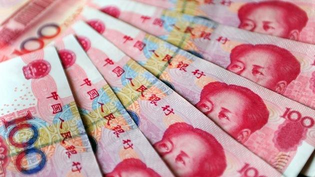 Jaque al dólar: El uso del yuan chino en el comercio internacional creció un 50% en 2012