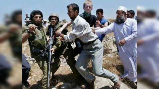 Palestinos e israelíes se manifiestan contra el muro de seguridad