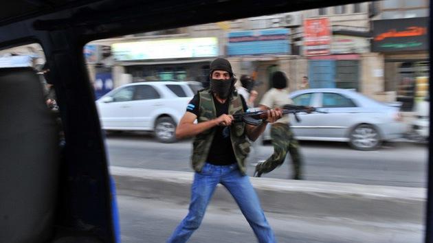 Insurgentes sirios mutilan cadáveres de compañeros para ocultar su nacionalidad