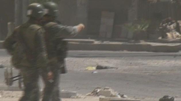 FOTOS: Hallan una fosa común en una zona tomada por los rebeldes sirios
