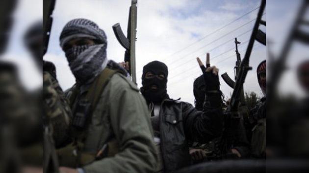 """Testigo en Homs a RT: """"los revolucionarios disparan y cortan en pedazos a la gente"""""""