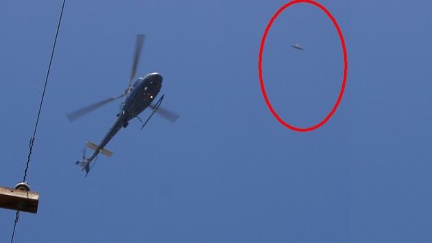 Captan imagen de un ovni, volando junto a un helicóptero de la Policía en Los Ángeles