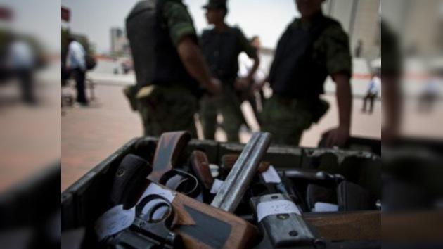 En la capital mexicana canjean armas por dinero a ciudadanos