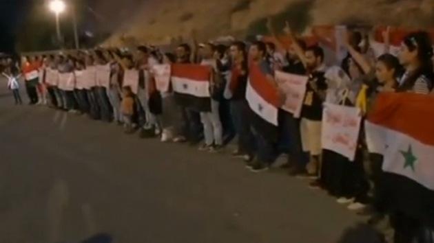 Activistas forman un 'escudo humano' para proteger a Siria de la intervención